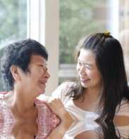 happy caregiver and senior