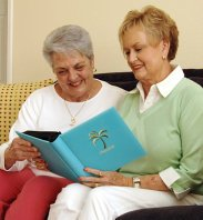 caregiver and old woman reading books