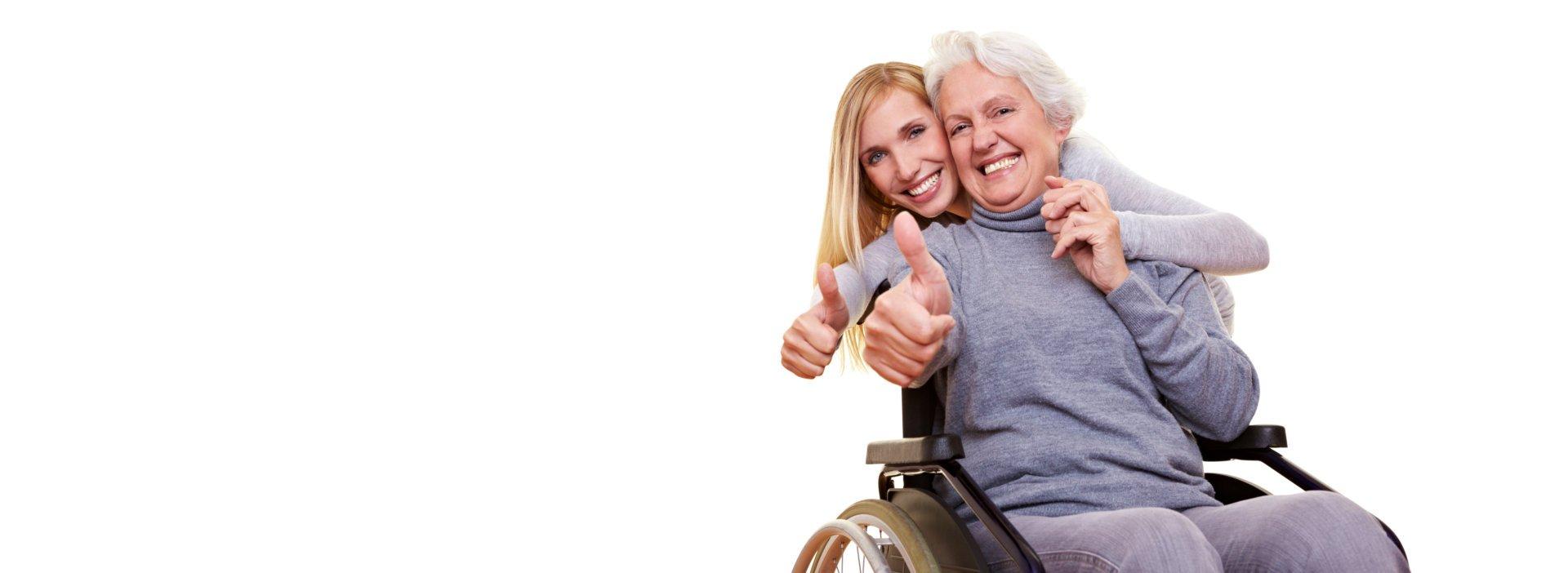 woman hugging an elderly woman