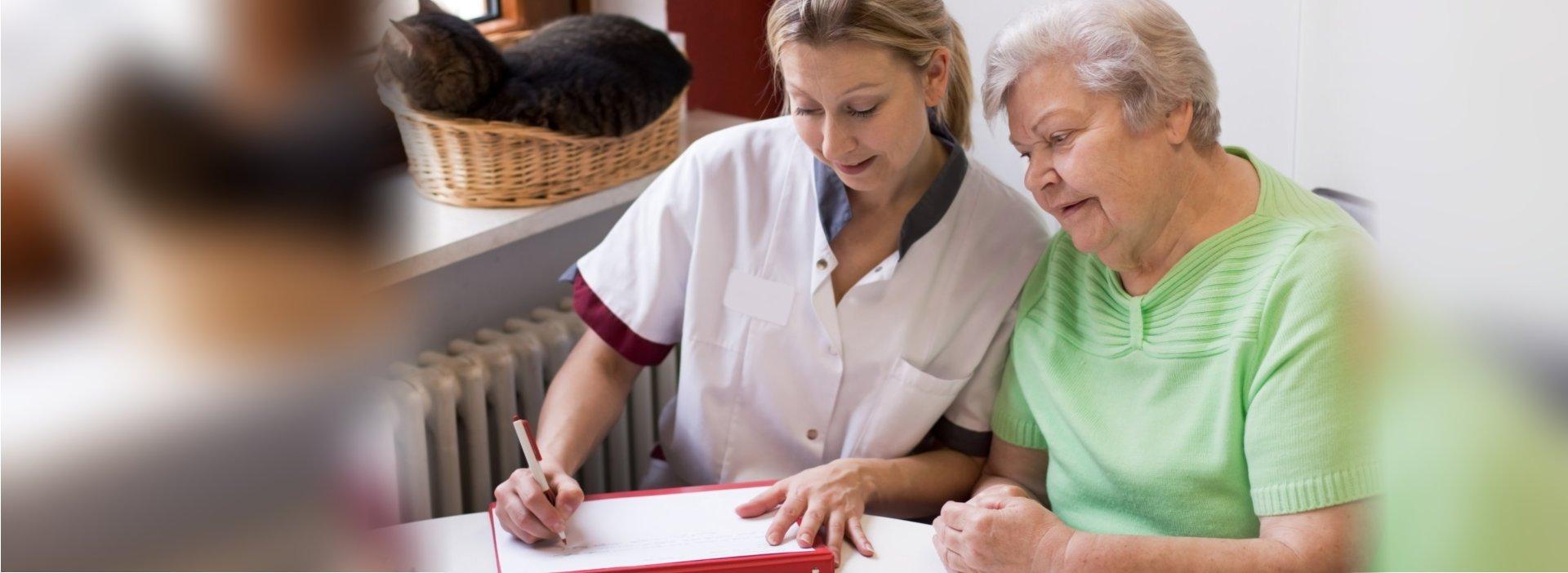 caregiver teaching an elderly woman