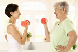 caregiver and elderly woman doing physical therapy