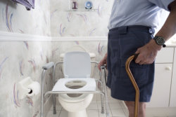 man cleaning the toilet