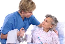 senior and nurse talking each other