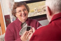 senior couple playing cards