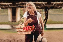elderly woman carrying a basket